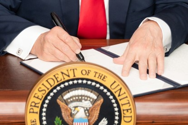 Trumps Hand Is Stretched To The Pen